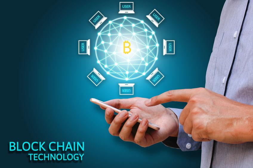 Blockchain technology concept, Businessman holding smartphone an